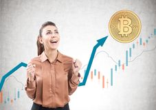 Happy woman in brown, bitcoin, graphs Stock Photo
