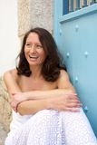 Happy woman with brown hair laughing outside Stock Image