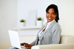 Happy woman browse the Internet on laptop Stock Image