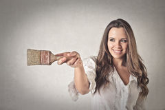 Happy woman with a brush Royalty Free Stock Images