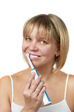 Happy woman brushing teeth and smiling isolated Royalty Free Stock Photography