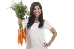 Happy woman with a bunch of carrots. Isolated on white royalty free stock photography