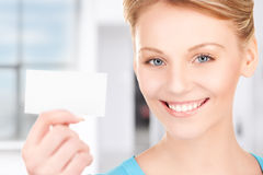 Happy woman with business card. In office Stock Photography