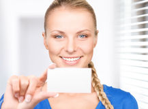 Happy woman with business card. In office Royalty Free Stock Photos