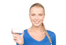Happy woman with business card. Over white Royalty Free Stock Photography