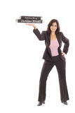 Happy woman in business suit holding pizzas Stock Photos