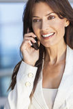 Happy Woman or Businesswoman Talking on Cell Phone Royalty Free Stock Image