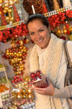 Happy woman buying Christmas balls at shop Stock Image