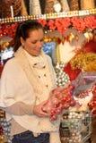 Happy woman buying Christmas decoration Stock Photos
