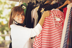 Happy woman buying clothes Stock Image