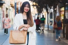 Woman buying in comercial street. Happy woman buying in comercial street Royalty Free Stock Photos
