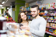 Happy woman buying food with boyfriend Stock Photos