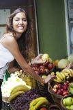 Happy woman buying fruits Stock Photos
