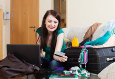 Happy woman buying hotel or ticket at internet Stock Photo