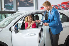 Happy woman buying a new car Royalty Free Stock Image
