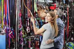 Happy Woman Buying Pet Leash With Man At Store Royalty Free Stock Photography