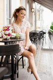 Happy woman in cafe. A happy beautiful young woman are drinking tea. Outdoors Stock Photos