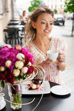 Happy woman in cafe Stock Images