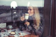 Happy woman in cafe stock photo