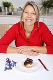 Happy woman with cake royalty free stock photography