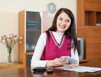Happy  woman calculating the family budget Royalty Free Stock Images