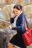 Happy woman calling hurried traveling luggage phone Royalty Free Stock Images