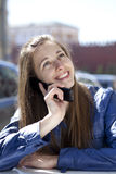 Happy woman calling by phone on the street Stock Photo