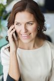 Happy woman calling on smart phone at restaurant Royalty Free Stock Photo