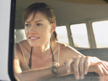 Happy Woman In Campervan During Road Trip Royalty Free Stock Photography