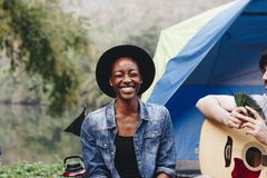 Happy woman at a campsite. Happy women at a campsite Royalty Free Stock Images
