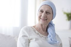 Happy woman in cancer headscarf royalty free stock photo