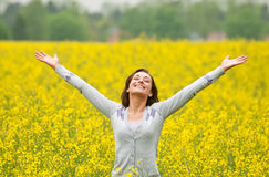 Happy woman in canola field Royalty Free Stock Images