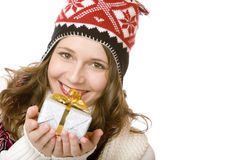 Happy woman with cap is holding Christmas gift Stock Photography