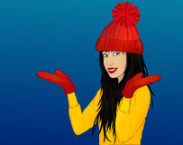 Happy woman in a cap and mittens show gesture with both hands Stock Images