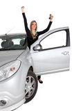 Happy woman on a car Stock Image