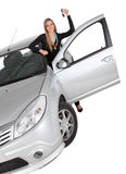 Happy woman with a car Stock Image