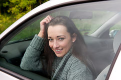 Happy woman in the car stock photos