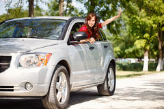 Happy woman in car royalty free stock image