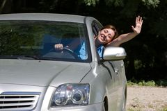 Happy woman in car stock images