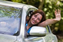 Happy woman in car. Young woman happy about her new car Stock Photography
