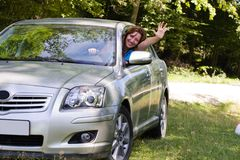 Happy woman in car. Young woman happy about her new car Royalty Free Stock Photos