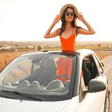 Happy woman in car cabriolet. Outdoor lifestyle photo of beautiful happy woman in car cabriolet. Holiday and travel. Summer trip. Freedom, youth and carefree Royalty Free Stock Image