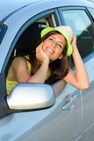 Happy woman in car daydreaming Royalty Free Stock Photography