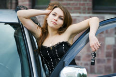 Happy beautiful fashion woman by her car Stock Photos