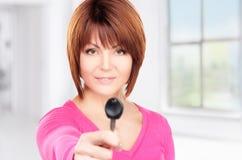 Happy woman with car key Stock Photos