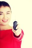 Happy woman with a car key. Royalty Free Stock Photo