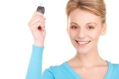 Happy woman with car key Royalty Free Stock Photo
