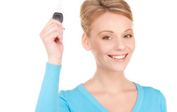 Happy woman with car key Royalty Free Stock Images