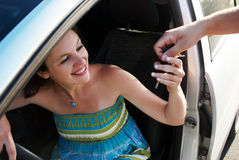 Happy woman during car purchase Royalty Free Stock Photo