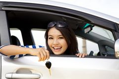 Happy woman in car showing the keys Stock Photo